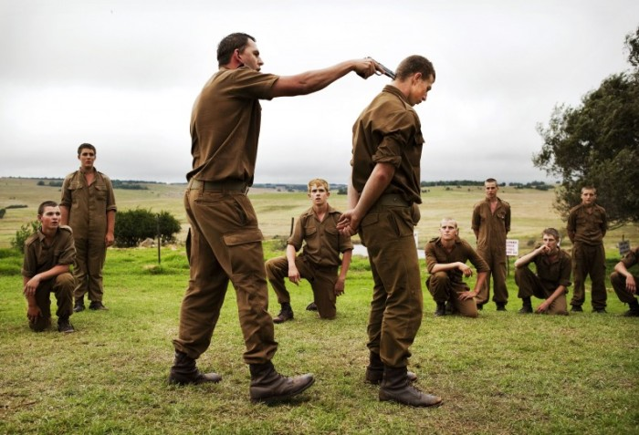 © Ilvy Njiokiktjien: World Press Photo: Afrikaner Blood              A sergeant shows boys at the Kommandokorps camp how to use a gun, South Africa.
