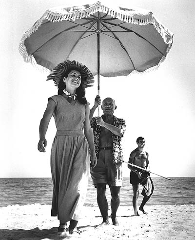 Pablo Picasso and Francoise Gilot (in the background is Picasso's Nephew Javier Vilaro), Golfe-Juan, France, 1948, Robert Capa Archive at the International Center of Photography, New York, Copyright 1996 Estate of Robert Capa