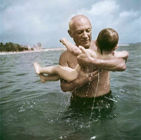 Pablo Picasso playing in the water with his son Claude, Vallauris, France, 1948. Photograph: Robert Capa/International Center of Photography/Magnum Photos