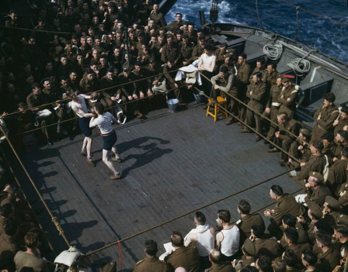 Robert Capa, [American and British soldiers watching a boxing match aboard boat from England to North Africa], June–July 1943. © International Center of Photography/Magnum Photos.