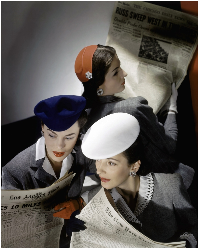 © Hort P. Horst: Models wearing hats and reading newspapers, 1943
